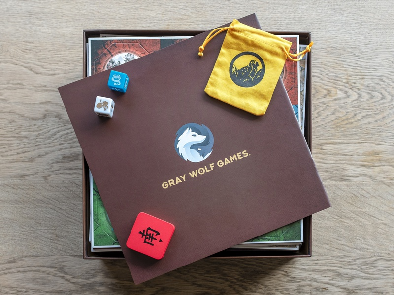 Gray Wolf Games In Real Life wu wei boardgames gray identity mark logo gradient animal packaging design print boardgame yin yang wolves wolf pup