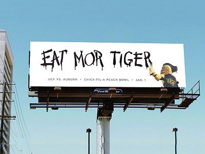 UCF vs Auburn Chick-fil-a peach bowl billboard school college sky marketing advertisement mural paint sports football sec