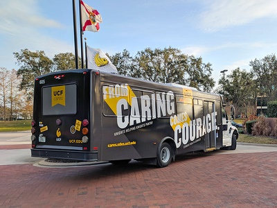 Bus Wrap college collage road highway engine gold black mural transit school florida university