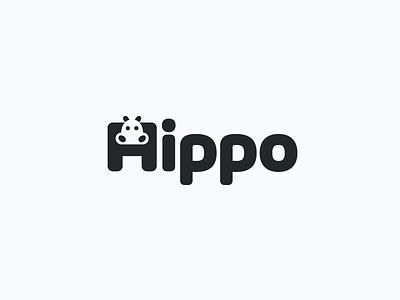 Hippo Logotype simple hippopotamus black and white unique creative typography font wordmark logotype initial h clever smart animal hippo negative space branding brand identity logo