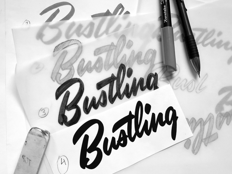 Bustling lettering type script brush typography