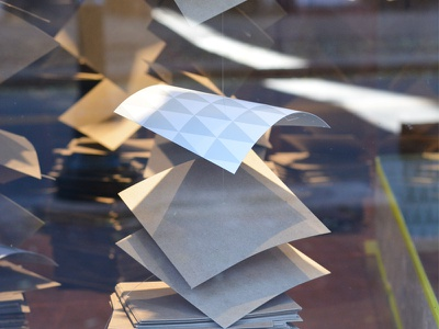 Floating Papers design installation art paper window display