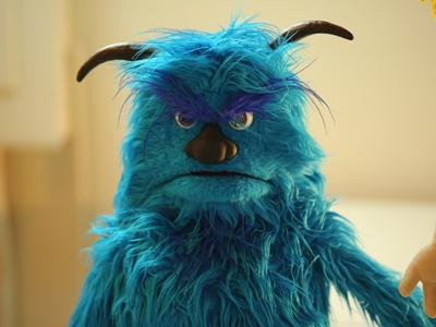 Grumpy blue puppet