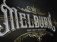 Handlettered logo design for Melburn smoking paper packaging