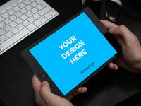 Black iPad Mini in hands by Shakuro