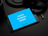 Black iPad Mini on black table by Shakuro