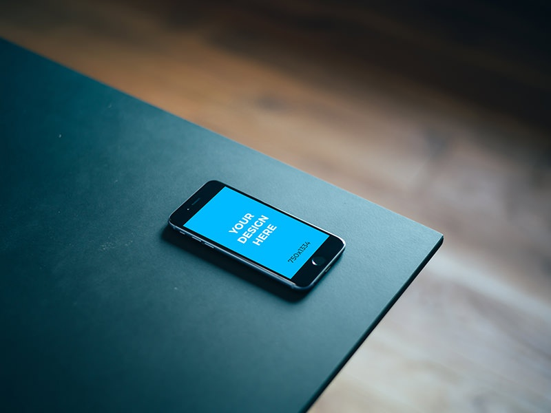 Black Iphone 6s In The Corner Of Black Table By Smartmockups