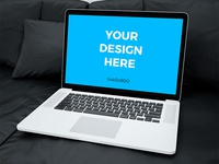 Free mockup - MacBook Pro Retina laying on black sofa