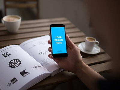 Woman with iPhone 6S reading a design book - Free Mockup