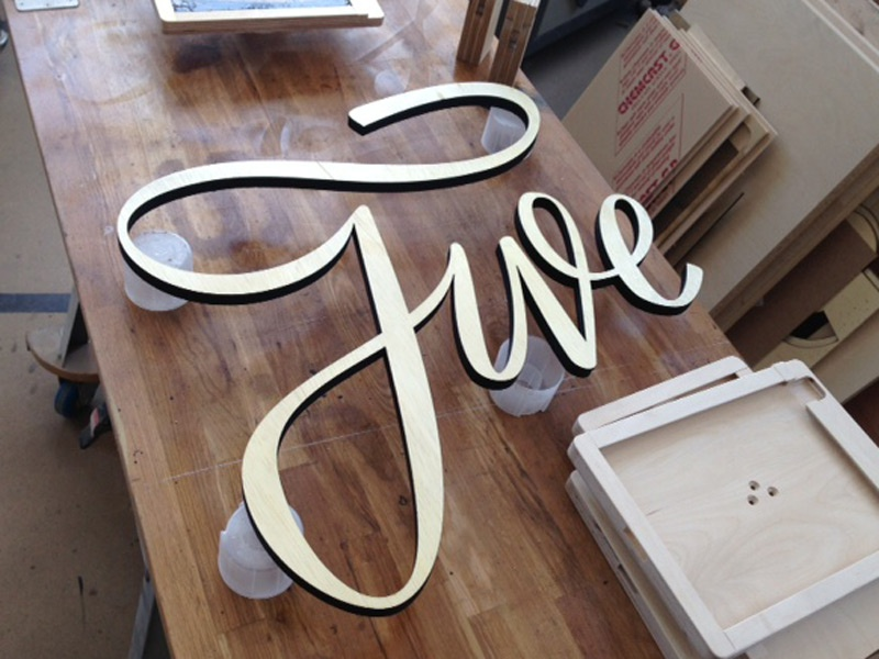 Five Sign five wood signage stationery show big ass sign