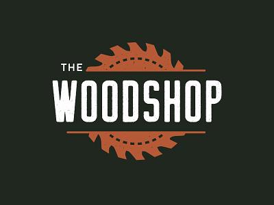 The Woodshop bold sans serif woodworking industrial branding logo