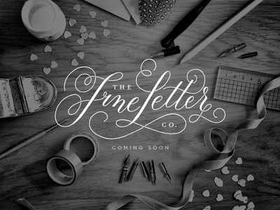 the fine letter co. handrawn black and white table top landing page the fine letter co. hand lettering modern calligraphy flourish photography website logo calligraphy
