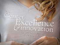 t-shirt logo for the Center of Excellence
