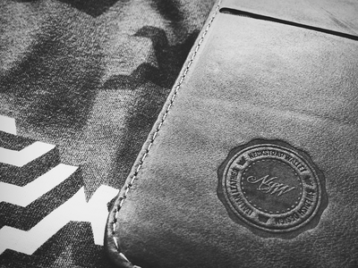 NSW logo - leather embossed