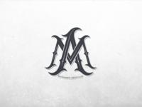 M+A monogram.