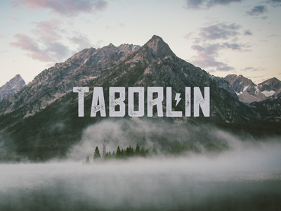 Taborlin the Great Logo taborlin mountain lightning bolt namer logo brand green fog unsplash