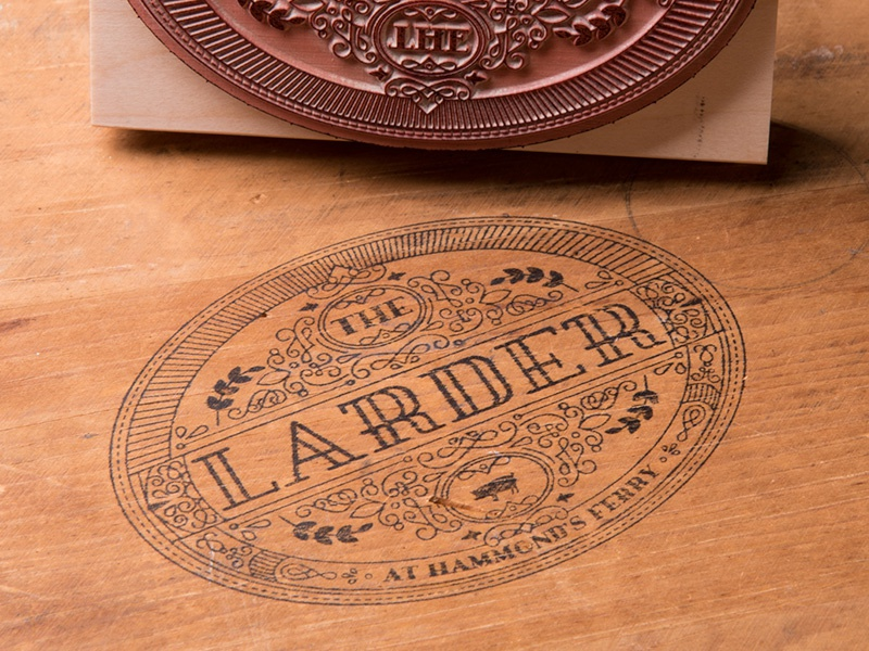 The Larder At Hammond's Ferry stamp pig line art seal restaurant logo