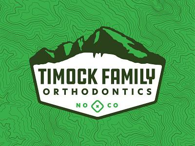 Timock Family Orthodontics modern molar mountain range horsetooth longs peak topo topographic map green orthodox orthodontics outdoors mountains branding logo