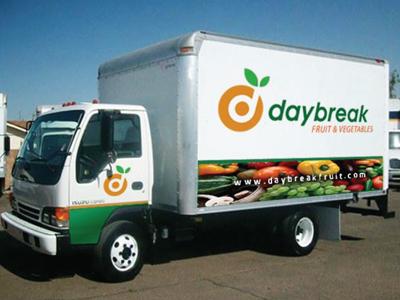 Daybreak Logo (On a Truck) orange d logo vector leaf green fruit target presentation truck rick landon rick landon rick landon design rick