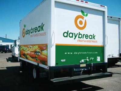 Daybreak Logo (On a Truck 2) orange d logo vector leaf green fruit target presentation truck rick landon rick landon rick landon design rick