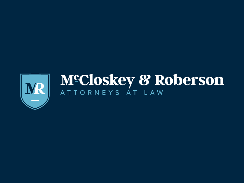 McCloskey & Roberson brand serif solicitor shield icon branding law law firm attorney legal logo
