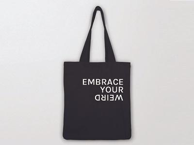 Embrace your weird kickstarter fidget to focus fidgetdidgets didgets fidget inspirational type product design tote bag black and white tote