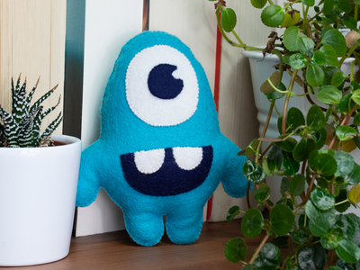 Cuddly Eddy blue kids art illustration cuddle design toy logo monster branding product cuddly toy