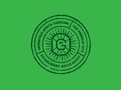 Emerald City sun badge seal north carolina emerald city emerald greenville
