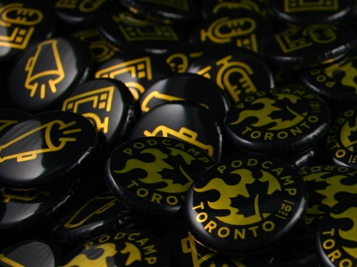 Black and Yellow buttons conference toronto swag podcamp