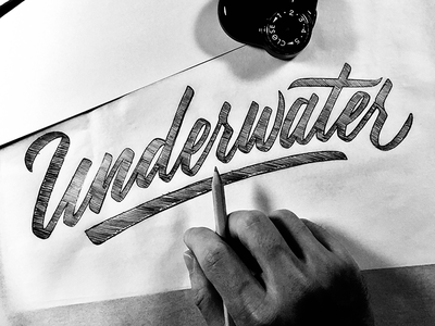 Underwater pencil calligraphy letters typeface font typography sketch lettering