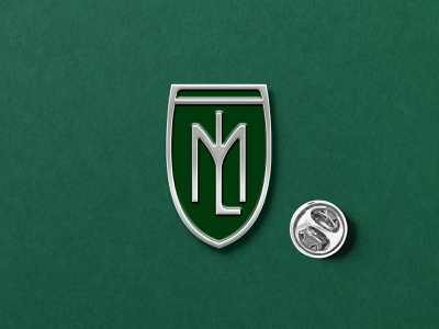 ML monogram brandmor branding shield shield logo logodesign art deco art nouveau silver metal button enamelpin enamel badge pin green design minimal typography logo monogram