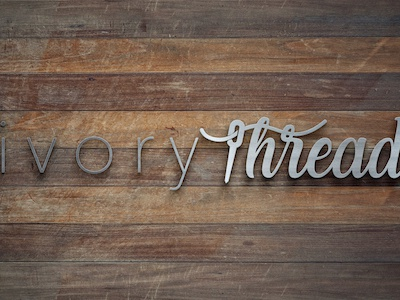 Ivory Thread Women's Boutique Logo boho boutique sewing needle hand lettered thread ivory apparel company womens boutique branding logo