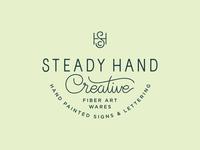 Steady Hand Alternate monogram script type lettering logo