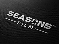 Seasons film on dark embroidered