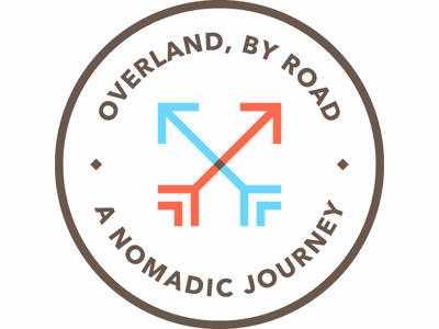 Overland, By Road adventure journey essay writing arrows nomad travel badge logo
