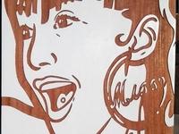 Hand-carved artwork on Mahogany wood