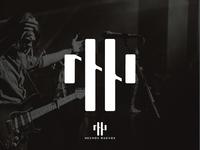 Hechos Nuevos monogram logo
