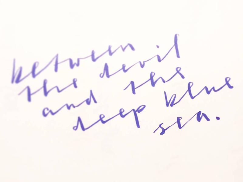 Between brushscript calligraphy typography handlettering lettering