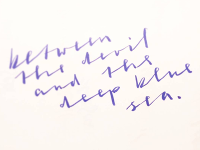 Between brushscript calligraphy typography handlettering lettering