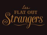 Les Flat Out Strangers Logo