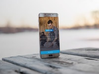 Android phone on wooden table showcase