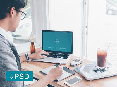 Man Working on a Macbook Pro (FREEBIE) apple free high-resolution mockup mock-up photorealistic photoshop psd workspace macbook