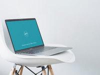 Macbook pro on fancy chair 1