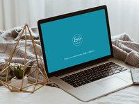 Apple macbook pro on bed 1