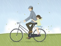 Father and daughter riding bicycle in the rain