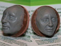 Polymer clay face on coin