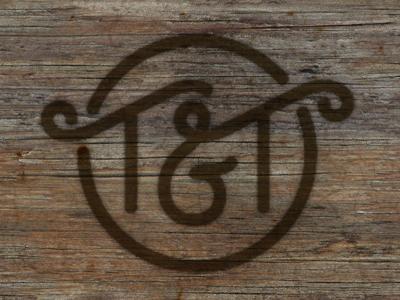 T&T Mark burn ligature type lettering logo mark cattle brand