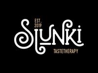 Slunki Tastetherapy logo