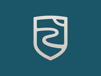 shield logo + nature scene