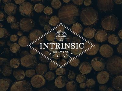 Intrinsic Brewing Logo vintage roots tree wood branding logo